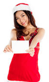 Sexy asian santa claus holding a blank business card