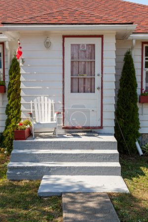 Photo for White porch of  house with clear green lawn - Royalty Free Image