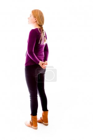 Woman with hands behind back