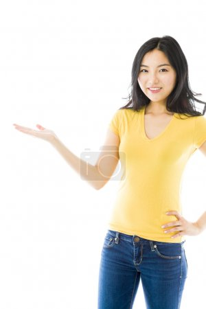 Photo for Young Asian woman showing product with open hand palm - Royalty Free Image