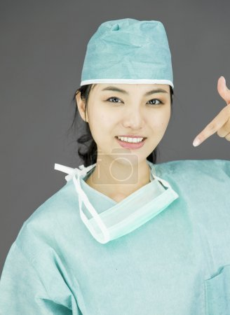 Surgeon pointing at herself