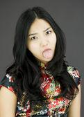 Woman poking out tongue