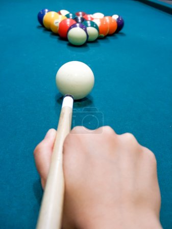 Photo for Snooker player opening shot on green billiard table - Royalty Free Image