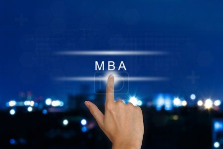 hand pushing The Master of Business Administration (MBA or M.B.A
