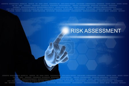 business hand clicking risk assessment button on touch screen