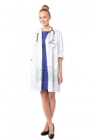 Relaxed female doctor standing with crossed legs
