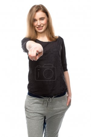 Smiling woman pointing at the camera