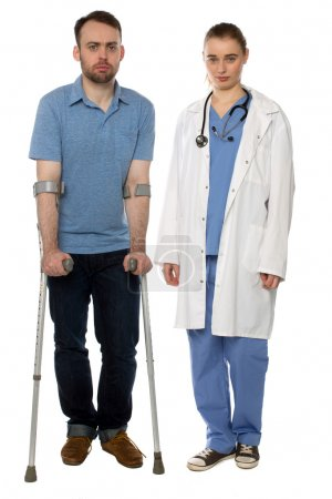 Man on Crutches and Lady Doctor Standing