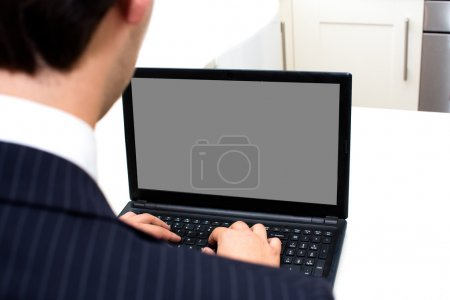 Businessman working at a laptop - blank screen