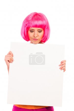 Beautiful young woman looking at blank white board.