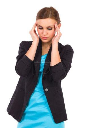 Young businesswoman having headache.