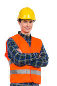 Confident construction worker with crossed arms.