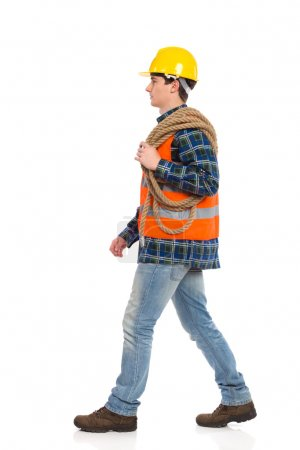 Walking construction worker with rope.