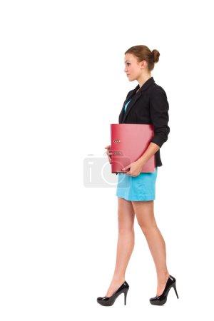 Walking businesswoman. Side view.