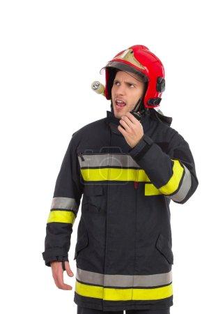 Firefighter using walkie-talkie