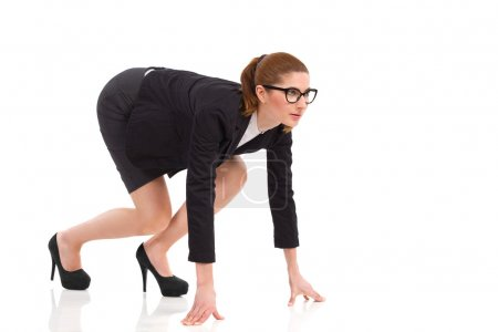 Businesswoman on all fours on the starting line.