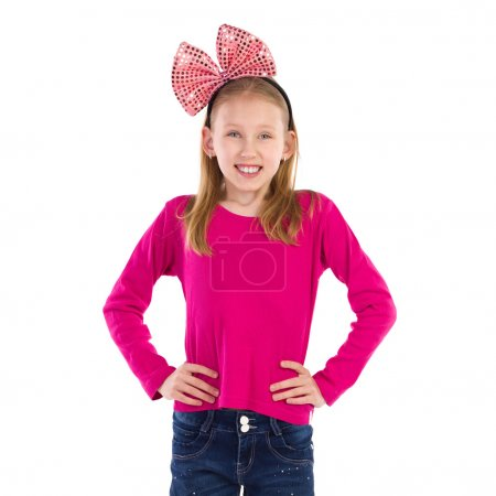 Smiling girl with hair bow.
