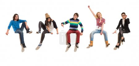 Group of happy people sitting on a big banner