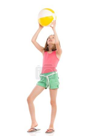 Girl playing beach ball