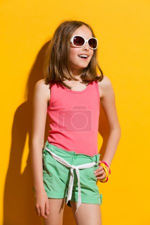Little girl on yellow background