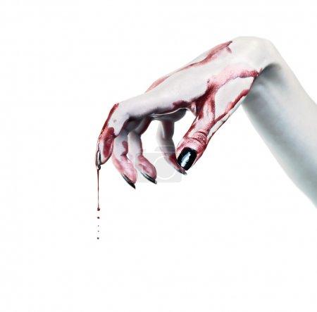 Photo pour Gouttes de sang sur la main morte - image libre de droit