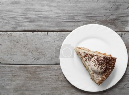 Photo for Piece of cake on the wooden table, top view, space for text - Royalty Free Image
