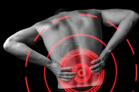 Acute pain in a male lower back, monochrome  image...