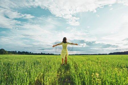 Woman in a green field