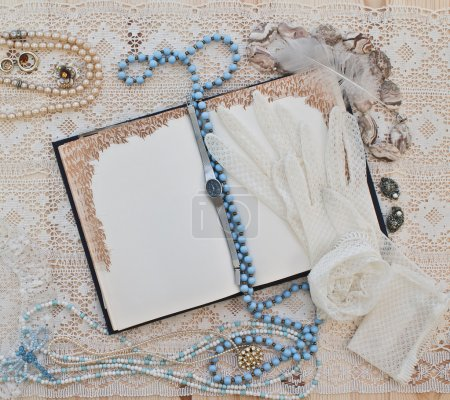 Women's jewelry and open notebook