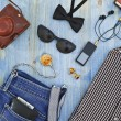 Set of men's clothing and accessories on blue wood...