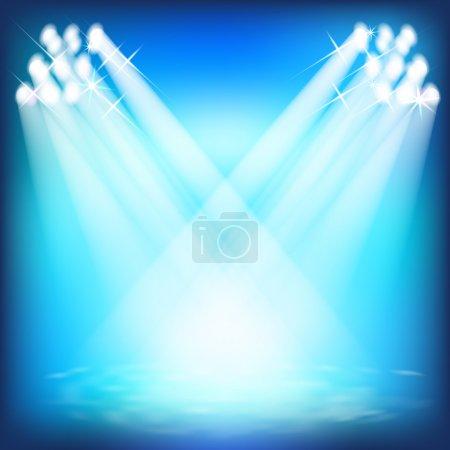 Spotlights and floodlights illuminate the scene. Laser light sho