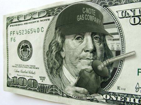 Ben Franklin on Hundred Dollar Bill Illustrates High Gas Prices