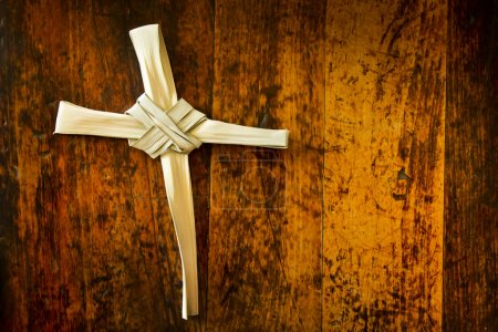 Cross Made From Palm Sunday Branch on Old Wooden Bench