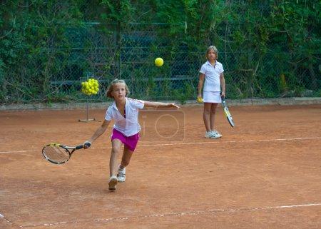 girls in training tennis