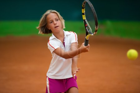 Athlete girl with racket on tennis court