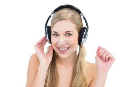 Pretty young blonde woman enjoying music