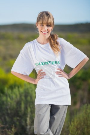 Cheerful natural blonde wearing a volunteering t shirt