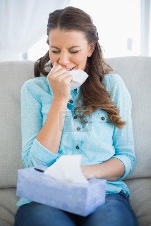 Woman crying sitting on sofa
