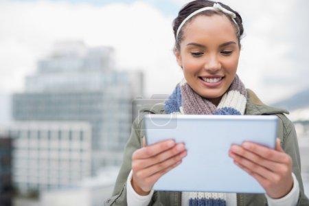 Attractive smiling woman using tablet