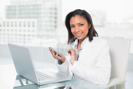 Young businesswoman using a mobile phone