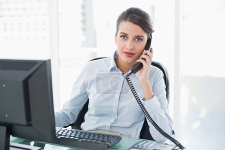 Businesswoman answering the telephone