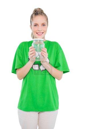 Content blonde activist holding glass jar