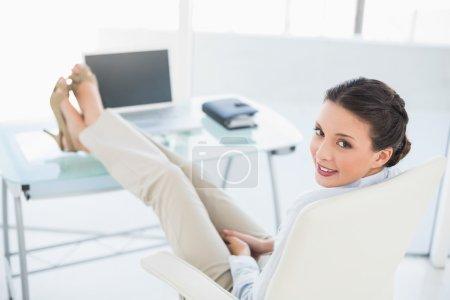 Pleased stylish brunette businesswoman enjoying her break
