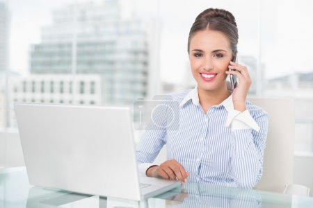 Cheerful businesswoman phoning