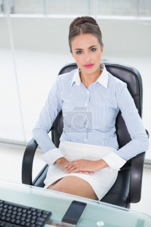 Content businesswoman sitting at desk