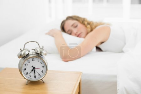 Pretty calm blonde lying in bed sleeping