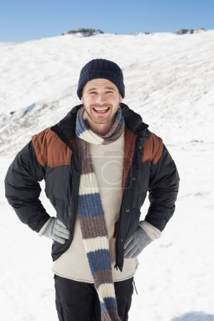 Man in warm clothing standing on snowed landscape