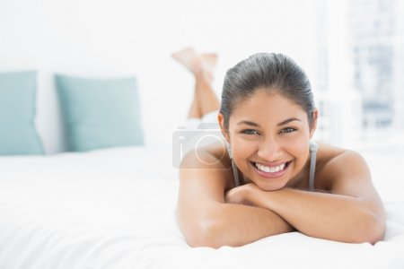 Portrait of a pretty woman lying in bed