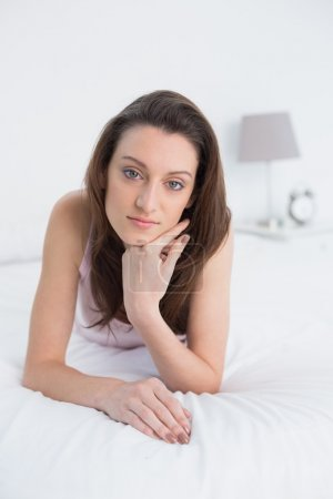 Close up portrait of a pretty woman resting in bed
