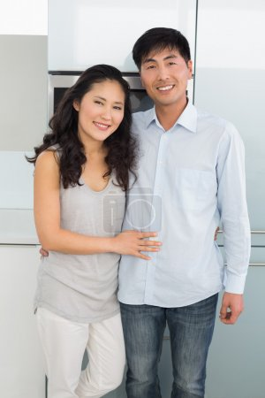 Photo for Portrait of a smiling young man and woman in the kitchen at home - Royalty Free Image